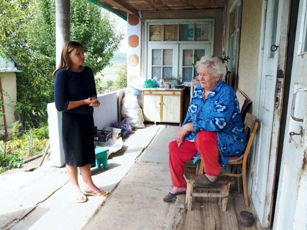 Moldova: Catea talking to one of the elderly she visits daily: Traumatized by her past, Catea never wanted to return, but God led her back to her home village, where today she brings a daily warm lunch to neglected elderly and shares God's love with them. More Info