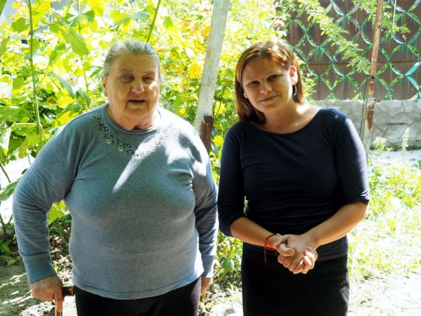 Moldova: Catea with one of the elderly she visits daily: Traumatized by her past, Catea never wanted to return, but God led her back to her home village, where today she brings a daily warm lunch to neglected elderly and shares God's love with them. More Info