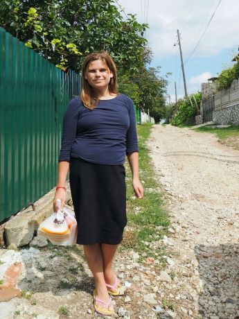 Moldova: Catea on her way through the village to deliver food to the elderly: Traumatized by her past, Catea never wanted to return, but God led her back to her home village, where today she brings a daily warm lunch to neglected elderly and shares God's love with them. More Info
