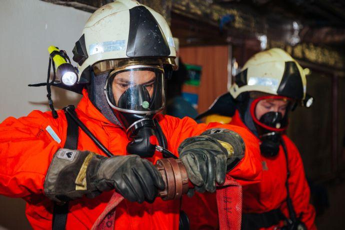 Saint Lucia: Castries, Saint Lucia :: Jareht Gradiz (Nicaragua) wears firefighting equipment during a training drill. More Info