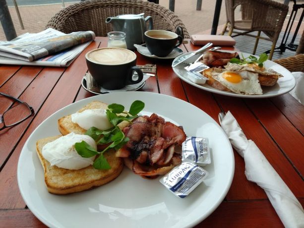 Indonesia: Richard enjoys bacon and eggs with coffee at an Adelaide cafe by the beach. More Info