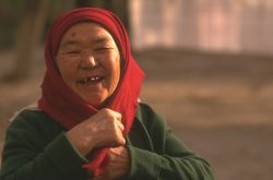 Close-up of an old Central Asian woman laughing at the camera