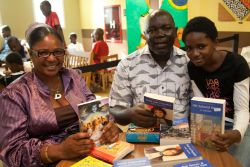 Tema, Ghana :: Local visitor Kofi de Heer-Menlah and his family show the books they purchased in the Logos Hope book fair.