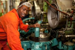 Takoradi, Ghana :: Project Worker Paul Amanor (Ghana) smiles for the camera in the engine room.