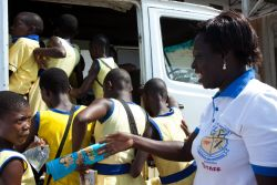 Takoradi, Ghana :: School Teacher Madam Hanna assists her students back to their school bus after a visit to Logos Hope.