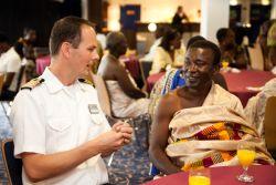 Takoradi, Ghana :: Captain Dirk Colenbrander (Netherlands) speaks with Chief Kwesi Ageymang of Dixcove.