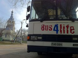 The Bus4Life in Moldova alongside an Orthodox church.