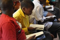 Children attending OM South Africas Meetse a Bophelo Center with their Bibles