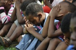 Children pray during a Bible lesson in Meetse a Bophelo (Living Water) Centre in Mamelodi, South Africa.