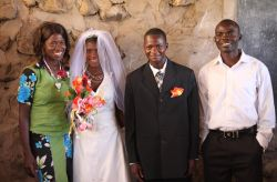 Missionaries Lewis and Priscilla Musonda with Moses and Marjorie, the first couple to be wed legally in Tongwa Village on the shores of Lake Tanganyika.