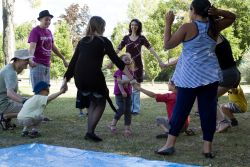 A little girl from Carpentras, Southern France laughs inside the ring of a holiday club game.