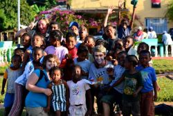 Caitlin and other team members play with kids on Sainte Marie Island, Madagascar.