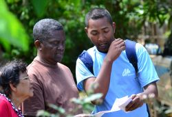 An OM team member shares the gospel with locals on Sainte Marie Island.