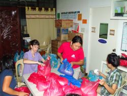 The OM Philippines team prepares flood relief packs