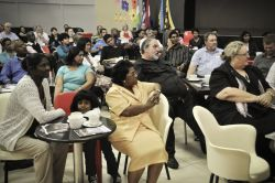 Prayer partners eagerly listen to ministry reports at the partnership day in Durban, South Africa.