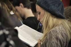 Mission Discipleship Training participant reads the Bible.