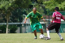 OM worker Nigel Keur (South Africa) playing football