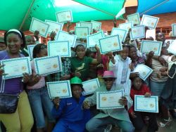 Excited children having received their diplomas after completing the Crossroads Curriculum.