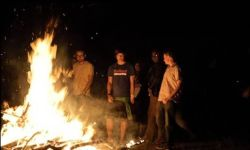 OMs latest group of Mission Discipleship Trainees (MDT) around a camp fire.