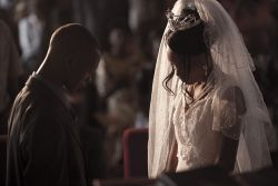 Isaac and Ruth Tembo bow their heads in prayer at the end of their wedding ceremony.