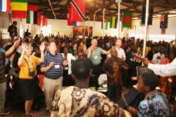 Love Africa conference attendees worshiping God together