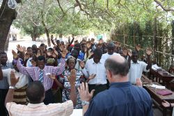 Francois Vosloo and Antonio Nipueda teaching and praying with trainees at the Mocuba Discipleship Training Base