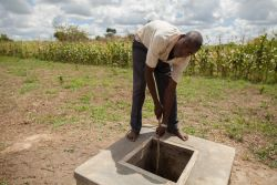 Francis, a worker with OM Malawi, draws water from a well at the ministry base.