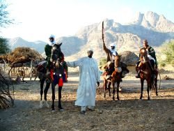 Group of nomads in Chad, 3 on horseback