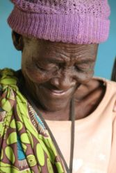 Granny smiles after being treated at a clinic ran by Vicky in Zimbabwe.