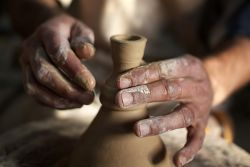 The hands of the potter in the Arabian Peninsula.   