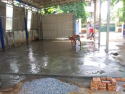 A concrete pad is laid for a new workshop near the front gates of Mercy Teams Internationals office in Phnom Penh, Cambodia.