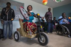 Joyce, a member of the Mpulungu Disabled Association, hits a tennis ball during a wheelchair camp in Kabwe, Zambia.