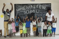 Students jump for joy at the new Chiyembekezo School.