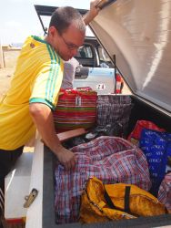 Nick Mortin (UK) from AIDS Hope is loading food parcels for distribution.