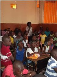 Kids in Angola listening to the Sad Book story during the Easter weekend