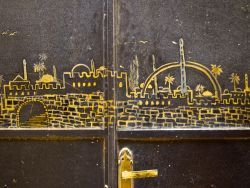 A door with an engraved image of Israel.  Photo by Inga Riley