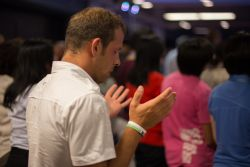 An Albanian participant spends time in prayer during Transform 2014