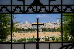 A cross overlays the view of Jerusalem. Photo by Garrett Nasrallah