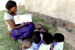 Teacher Catherine reading to children of the Chiyembekezo school for orphaned children in Malawi.
