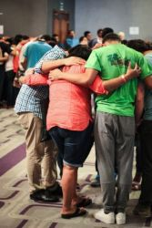 Participants of an international outreach in Panama are praying together for the week ahead.