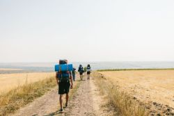A 'Love Moldova' trekking outreach team on its way through the Moldovan countryside. The trekking teams travel from village to village, organising children's programmes, visiting elderly and poor families and talking to people they meet on the way.
