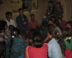 An OM Nepal Community Mobilization Team member passionately shares a key Old Testament story to a group of young listeners as part of his oral bible story ministry in a remote district.