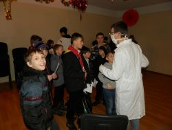 Children going through Fun Testing for infection of the sin virus during the introduction to the evangelistic winter camp in an orphanage in the Odessa province.