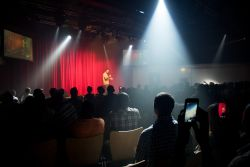 Dar es Salaam, Tanzania :: Daniel Heidari (Sweden) raps at the echoes of hope onboard event in the Hope Theatre.