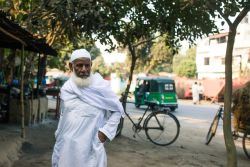 A local man pauses on the streets in Bangladesh.