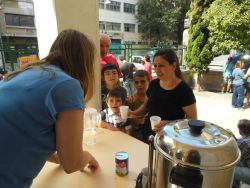 The tea station, OM Greece team member serving refugees and homeless people in Athens.