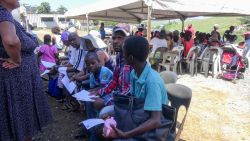 Durban, South Africa :: Members of the Waterloo Phase 6 community sit and wait in line for the Logos Hope mobile clinic.