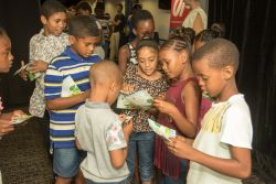 Durban, South Africa :: Children read through their new book, The Bible App for Kids Book of Hope, after an event on board Logos Hope.