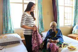 East London, South Africa :: Viola Muck (Germany) visits an elderly home where books and blankets were distributed.