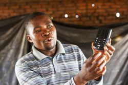 Careson, a friend of OM Malawi, explains how to use a solar-powered audioBible.